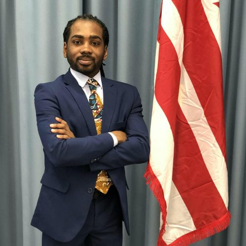 Councilmember Trayon White, Sr. with a DC flag